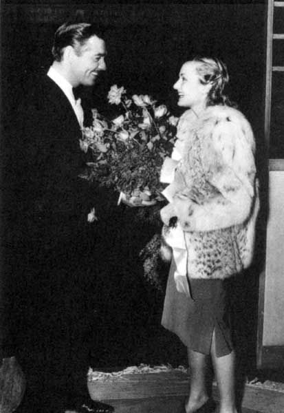 September 1940: Happily married Clark Gable keeps Carole Lombard's dressing room filled with red roses.