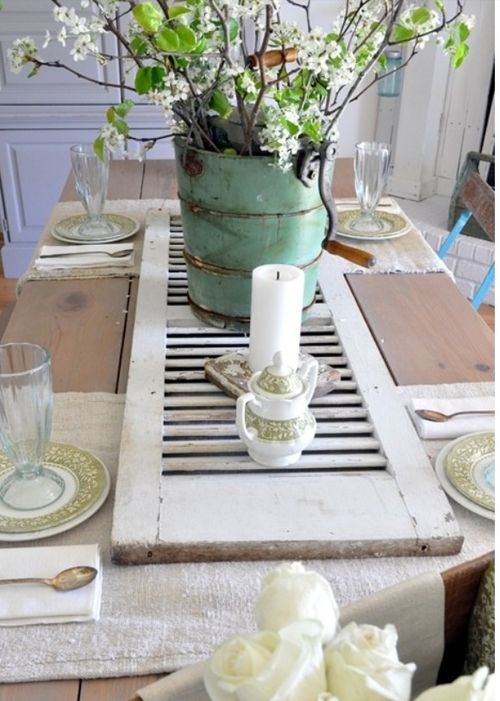 old shutter on barnwood table. Would be really cute for a wedding reception:)