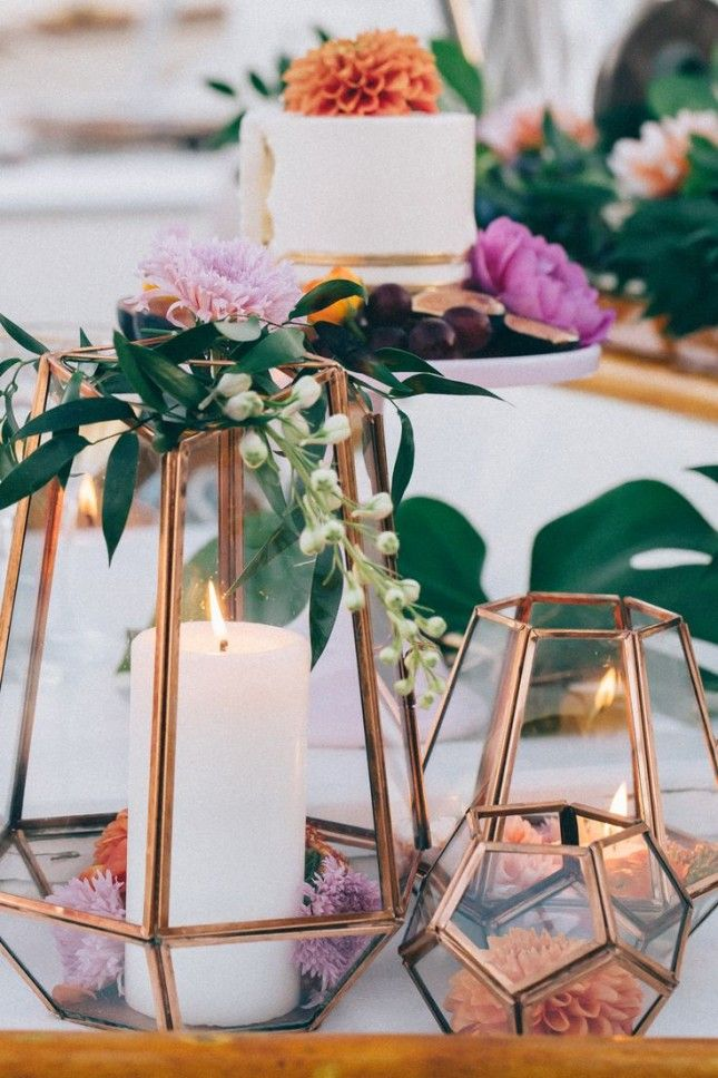 Tinge multi-faceted lanterns with copper for a dynamic centerpiece.