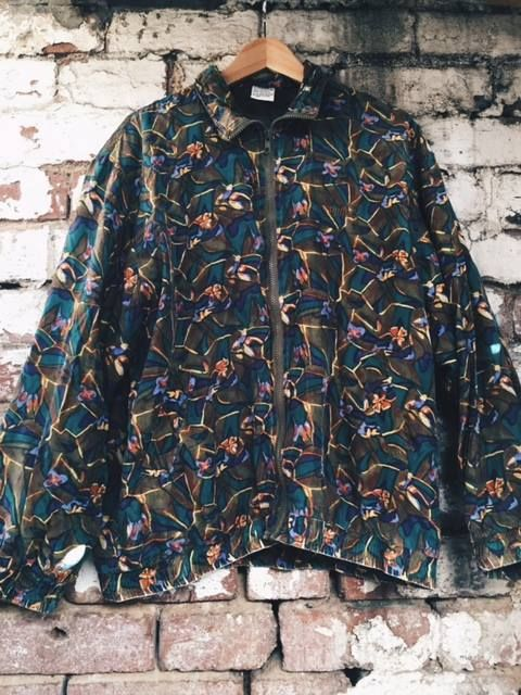 Vintage silk Puma bomber.. i mean.. seriously!:) www.storehousecharity.com
