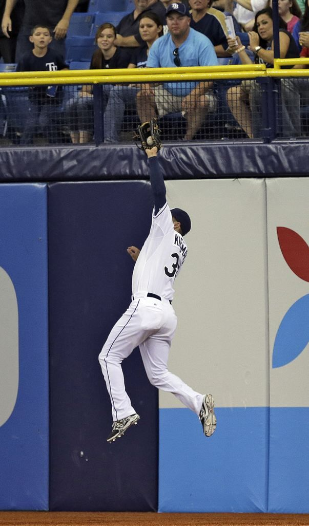 Tampa Bay Rays right fielder Kevin Kiermaier leaps high in the air to rob Milwaukee Brewers' Mark Reynolds of an extra base hit during the f...