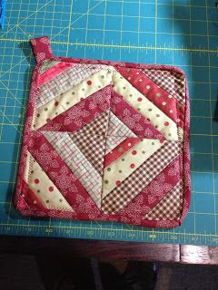 scrappy hotpad. Perfect beginner quilting project!!! No pattern but shouldn't be hard to create your own dimensions...