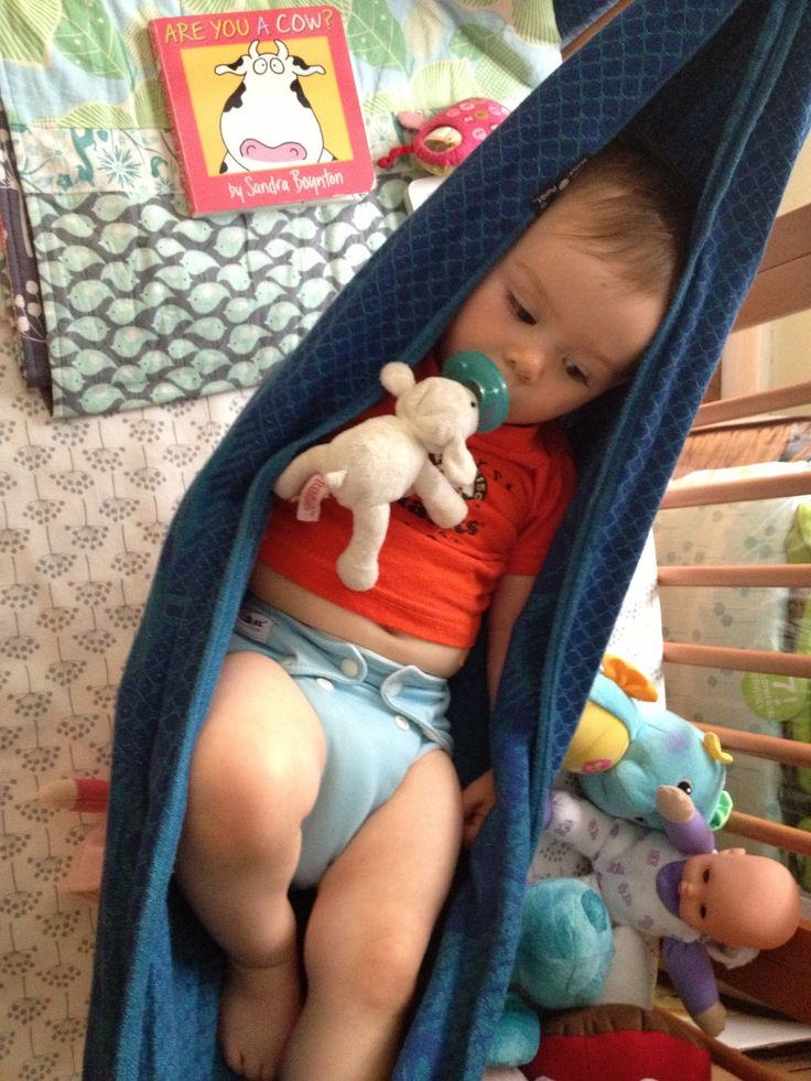 Woven wrap used as toddler hammock in crib