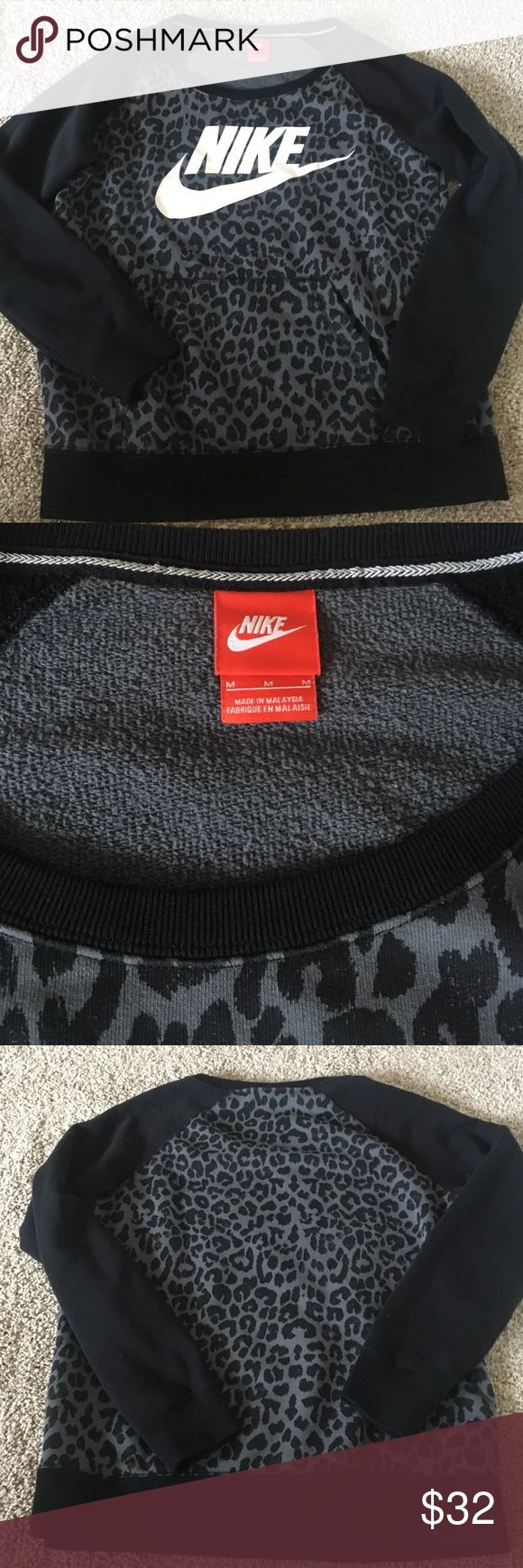 Nike crew neck sweatshirt size M Nike leopard print crew neck sweatshirt. Super comfy to wear over your workout clothes or just casually! In excellent condition Nike Tops Sweatshirts & Hoodies