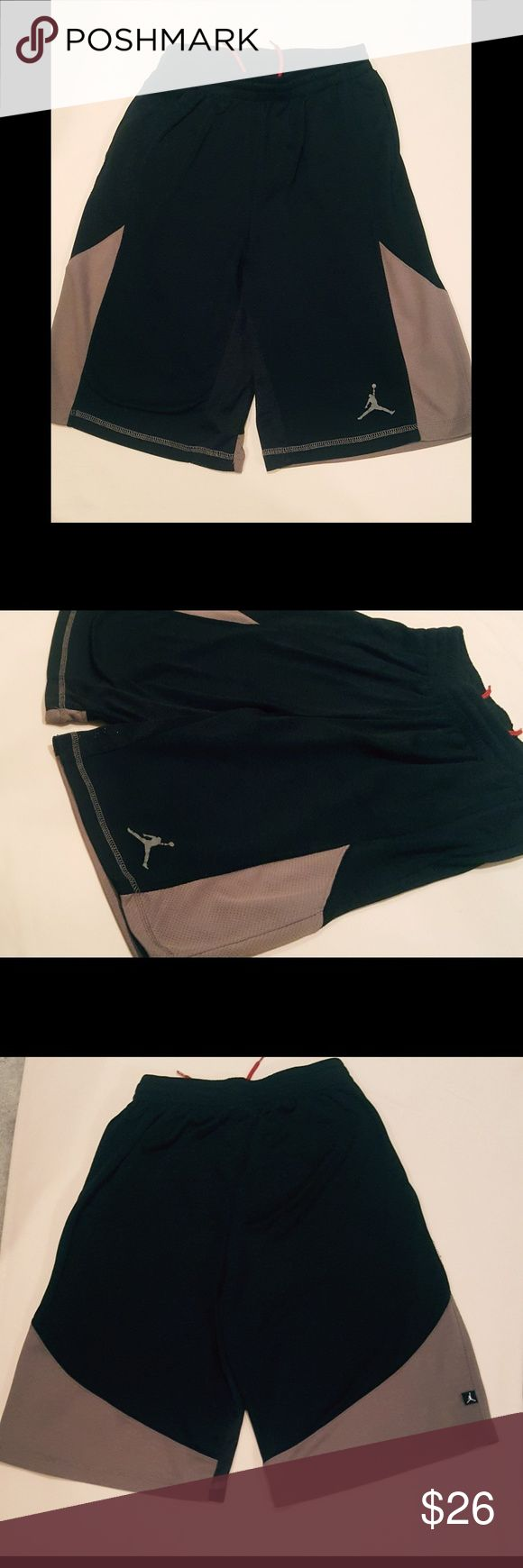 NWOT Jordan basketball shorts NWOT Jordans dri-fit basketball shorts. Juniors size xxl, fit as a woman's small. Shorts are black and grey with red drawstrings. Jordan Shorts