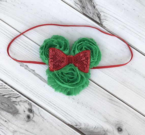 This adorable shabby chic Christmas Minnie Mouse Headband is perfect for any holiday gathering! The chiffon flowers with sparkly red bow is attached to an elastic headband with felt. The Minnie measures 3 1/4x 3 1/4. The flowers may have slight fraying, but that just adds to the