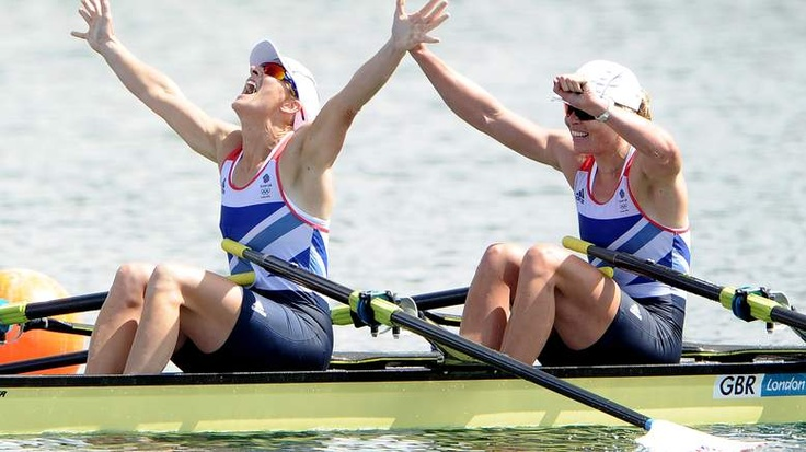 Katherine Grainger and Anna Watkins of Great Britain celebrate after winning gold in the Women's Double Sculls final on Day 7 of the London 2012 Olympic Games