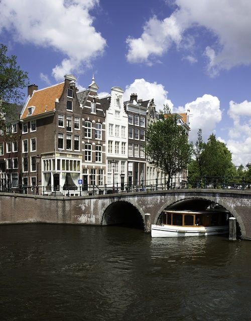 Amsterdam.  I spent a semester abroad there and absolutely fell in love.  A truly incredible city