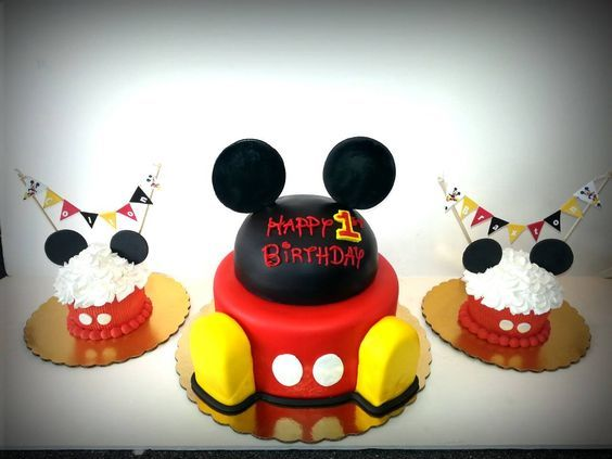Mickey Mouse two-tiered birthday cake and smash cakes for twins with paper banners - Cakes by Lake City Cakes in Coeur d'Alene Idaho -   http:// Facebook.com/Lakecitycakes http://lakecitycakes.com  #LakeCityCakes #MickeyMouse #2ndBirthday #DisneyCakes #SmashCake #CDAtastesGOOD