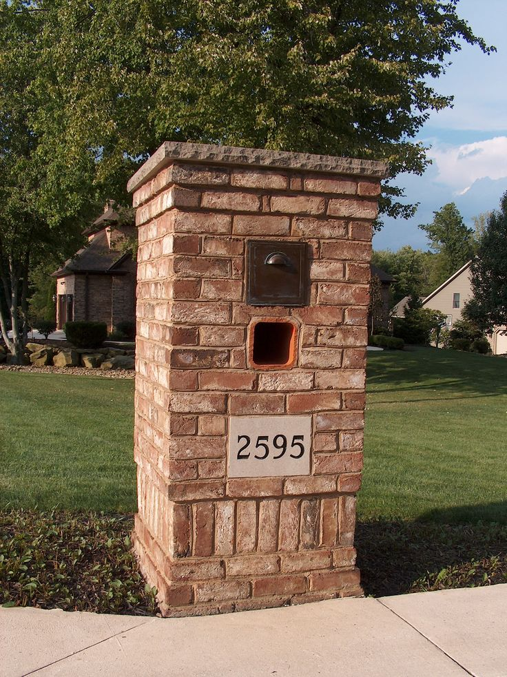This customer had a custom mailbox built, using a limestone street number marker, and a chiseled square cap of 2 1/4″ limestone. The paper slot is an 8″ square clay liner and the mailbox is a brass and copper mailbox, designed for a long life application. A soldiered brick base with a corbelled top adds the finishing touch to an elegant streetside application