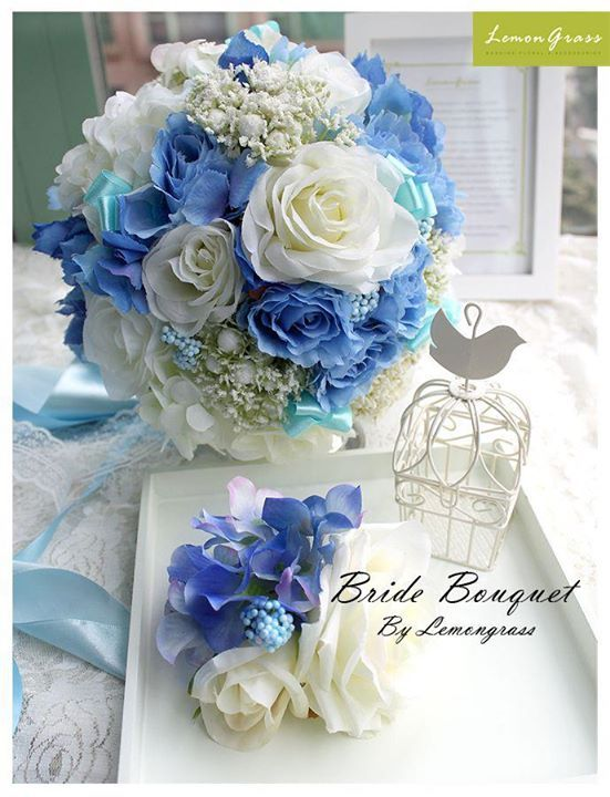 Wedding flowers: Cinderella theme bride bouquet comprises blue roses, white roses, baby breaths, deep blue and white hydrangeas, made by Lemongrass. Order from us! www.facebook.com/LemongrassWedding