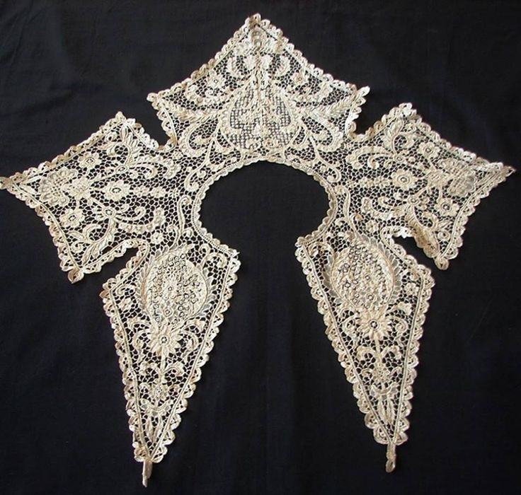 This lace collar is made in Irish Youghal lace (also known as point d'Irlande). It's a needle lace inspired by Italian needle lace and was first developed in Youghal, County Cork, Ireland.  This type of needle lace went into decline after World War 1 and there are very few practitioners left who do this kind of work.  Image courtesy of http://www.stellaniforos.com/p/archive.html