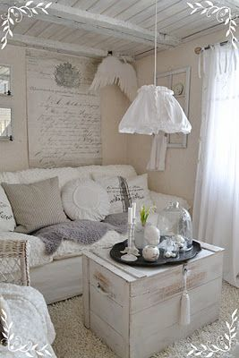 Make a small space cozy...love the wooden painted ceiling. And the super pale monochrome....