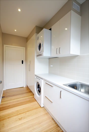 Why not upgrade your laundry too!  Having enough cupboards and drawers in your laundry can make it a pleasure to work in.  You don't have to use the most expensive finishes in the laundry for it to still have great style.  www.rosemountkitchens.com.au