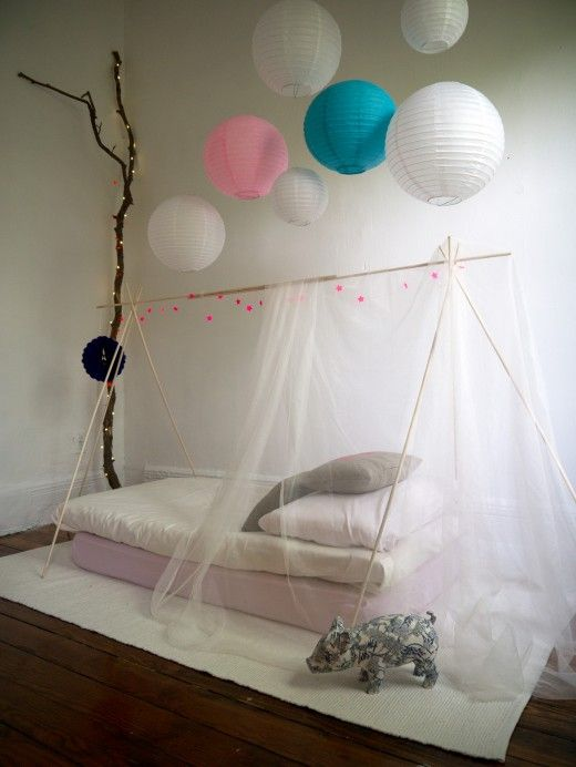 lovely for indoor camping out - or for sleep over guests! I have a tulle canopy for the girls' big girl bed. Love those lanterns!