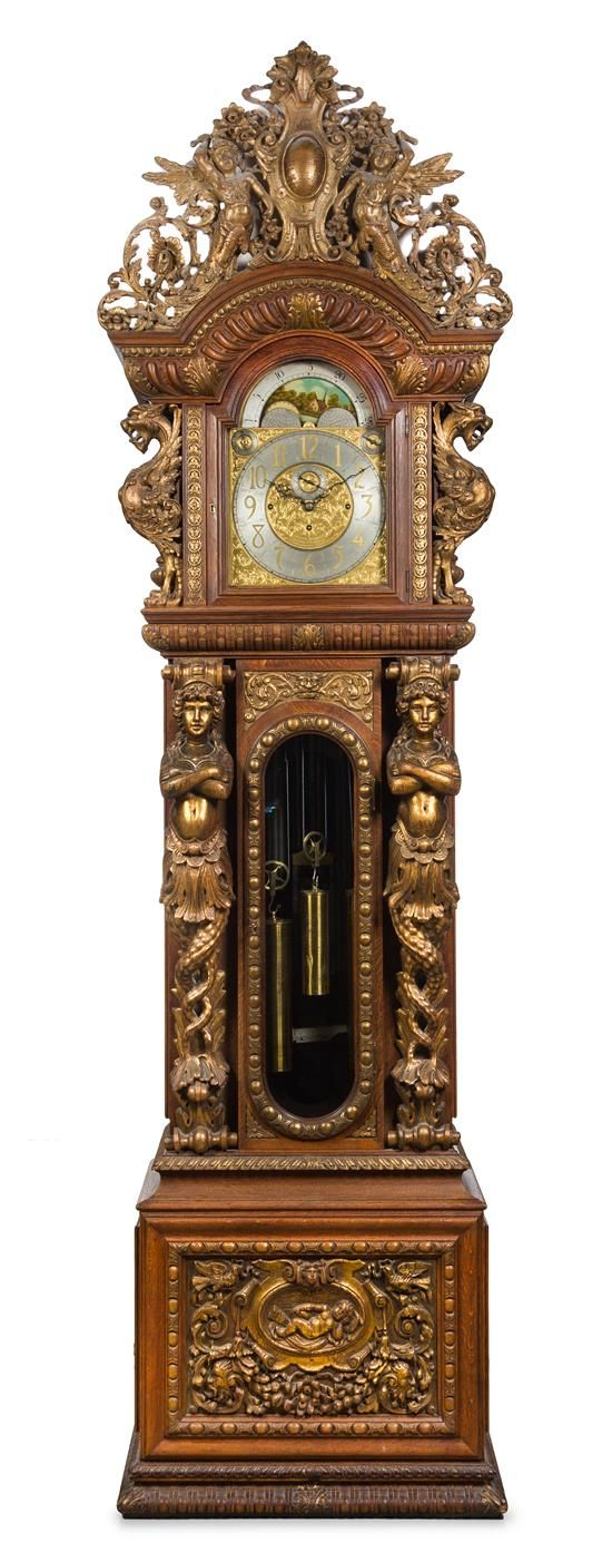 Monumental Victorian Carved Oak Eight-Tube Case Clock  case attributed to R. J. Horner, movement by Joseph Jennens, London, late 19th century .
