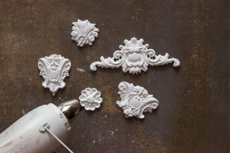 Cast Paper Clay embellishments using the Prima / Iron Orchid Vintage Decor Moulds: Baroque No. 3. PaperClay: https://www.amazon.com/Creative-Paper-clay-Ounces-White/dp/B001V8E7MW/ref=sr_1_sc_2?s=home-garden&ie=UTF8&qid=1473257321&sr=1-2-spell&keywords=prima+paper+clay Moulds: https://www.amazon.com/Prima-Marketing-814793-Baroque-Designs/dp/B01AMLHY2I/ref=sr_1_3?ie=UTF8&qid=1473257182&sr=8-3&keywords=prima+decor+moulds