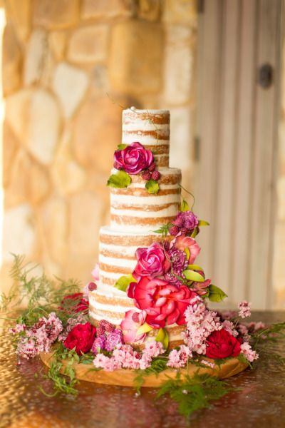 Naked wedding cake decorated with florals: http://www.stylemepretty.com/california-weddings/aptos/2014/10/08/outdoor-wedding-inspiration-filled-with-rustic-romance-at-devine-ranch/ | Photography: Mike Larson - http://mikelarson.com/