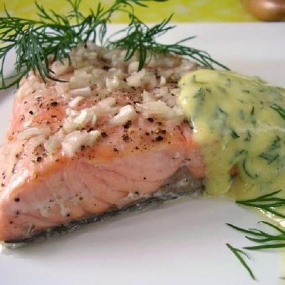 Pressure cooker salmon steaks with creamy mustard sauce. Fresh salmon steaks with dry white,mustard and vegetables cooked in pressure cooker. Serve cooked salmon steaks accompanied with dry white wine.