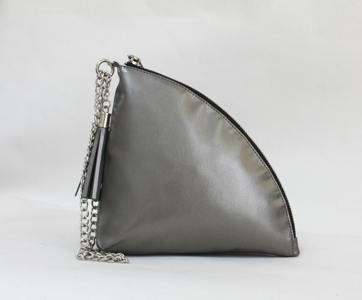 Zoey quarter clutch bag #clutchbag #taspesta #handbag #clutchpesta #fauxleather #leather #kulit #fashionable #stylish #trend #colors #darksilver Kindly visit our website : www.bagquire.com