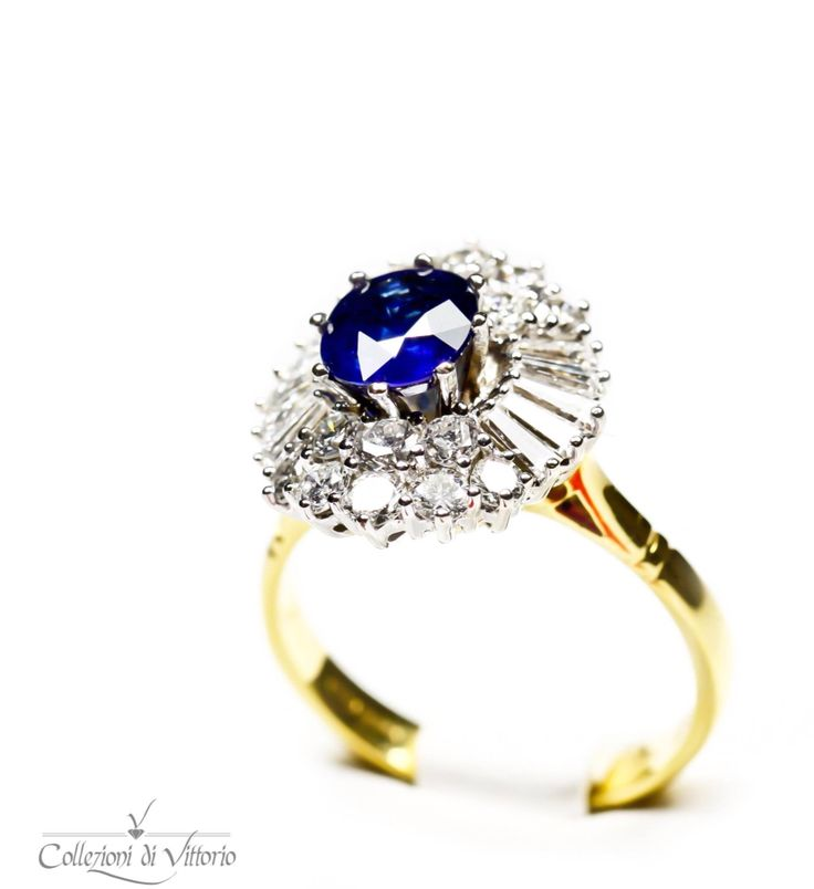 "Lady Diana with a ""Vittorian"" twist: here sits a beautiful blue Sapphire surrounded by tapered baguette and round Diamonds"
