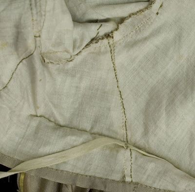 Tape detail of inside on crossover bodice of silk dress, 1810's. Originally from Vintage Textile.