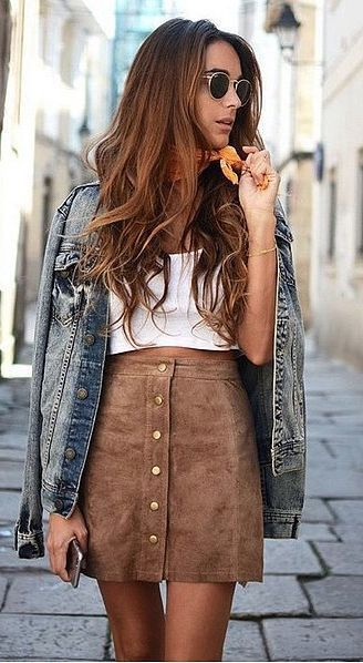 A suede skirt paired with a denim jacket and simple tee.