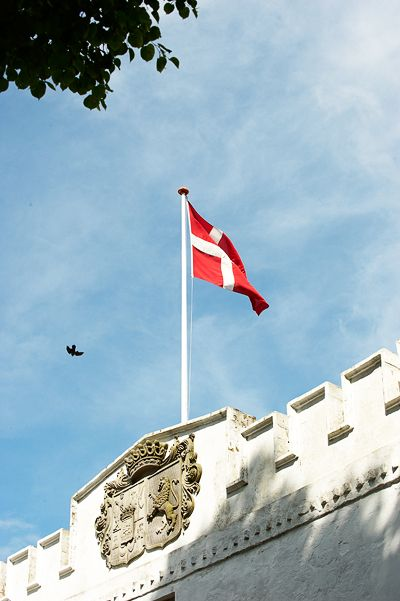 The Danish flag flapping over the main gate at Dragsholm Caste. www.dragsholm-slot.dk