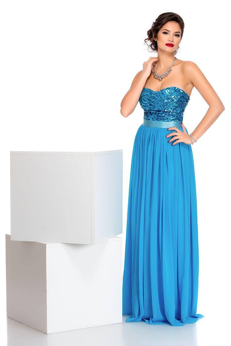 Rochie Tango Bleu - Rochie de seara eleganta fara bretele din voal bleu-turcoaz in partea inferioara si paiete in partea superioara este perfecta pentru evenimentele importante din viata ta.Daca vrei sa arati ca o adevarata diva trebuie sa ai aceasta rochia in garderoba.Talia este subtiata si pusa in valoare prin elasticul satinat. material usor elastic fermoar la spate bust buretat elastic satinat in talie jupon Produs in U.K. Dimensiuni disponibile: S, M, L, XL Colectia Rochii de seara…