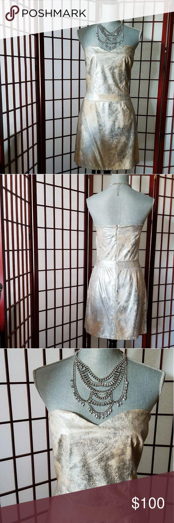 Silk metallic mini dress Silk metallic strapless mini dress. Cracked silver pattern on dress picks up light beautifully. Aaron Ashe Dresses Strapless