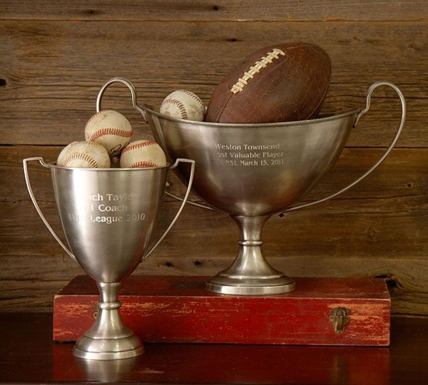 Fill old sports trophies with soft sports balls.