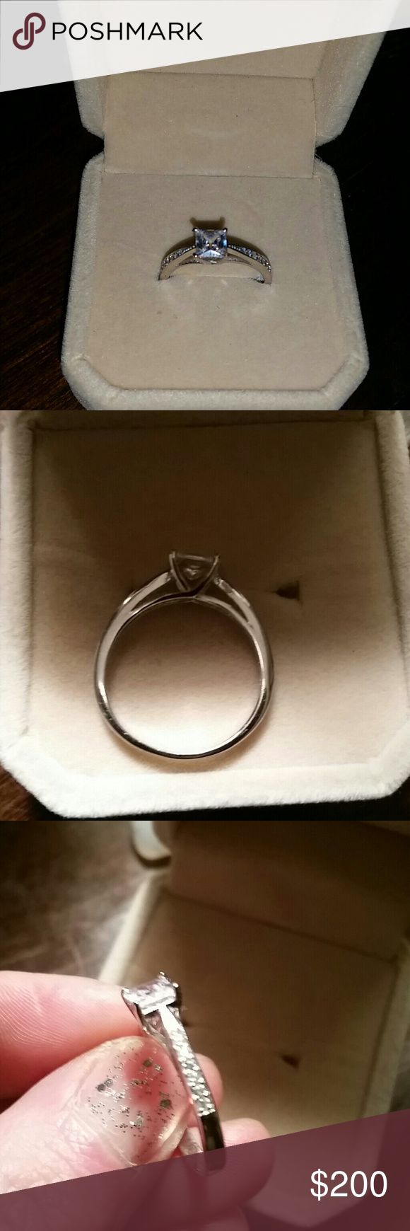 1ct Aneis De Diamante princess cut ring NEED GONE! I'm selling my engagement ring, no use for it. It is 1ct center stone with 6 pave' diamonds on each side. It is a Sona simulated diamond. Ladies, it's GORGEOUS. Super sparkly and honestly prettier than any of the diamond jewelry I have. 14k white gold Plated sterling silver. 925 hallmark stamp with the word Love engraved in it.  Size 7! Such a great deal, seriously this is THE classic solitaire, engagement ring! Comes in its velvet box…