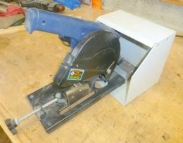 Bolt Cutting Saw - Homemade bolt cutting saw adapted from a cutoff saw. Bolts are held by an angle iron bracket drilled and tapped with metric and SAE bolt sizes.