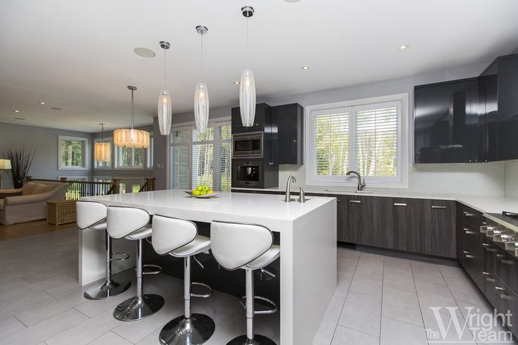 Located on a premier lot in the sought after neighbourhood of Rideau Forest, this Princiotta two-storey home sits on over three acres bordering woodlands at the rear. Upgraded lighting and decorative elements throughout, the kitchen is a study in contemporary design with high gloss lacquer finished cabinetry in stylish grey, juxtaposed against cabinetry with  grey striation. Two of the four bedrooms boast ensuite bathrooms for ultimate privac. $1,100,000.