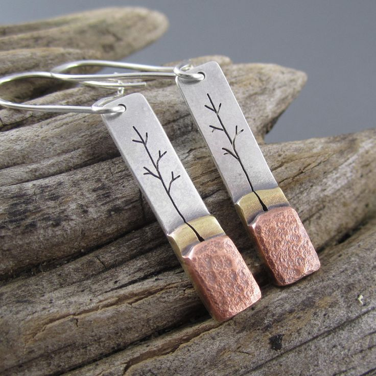 These handcrafted sterling silver, copper and brass earrings are inspired by the young aspen growing in the Upper Peninsula of Michigan. Product features: - Recycled Upper Peninsula copper from the Wh