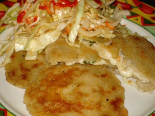 Pupusas Recipe ~ From the streets of El Salvador and Honduras, these are masa 'cakes' with a filling that is fried. The usual fillings are meat or cheese but there is no reason why beans etc could not be used.