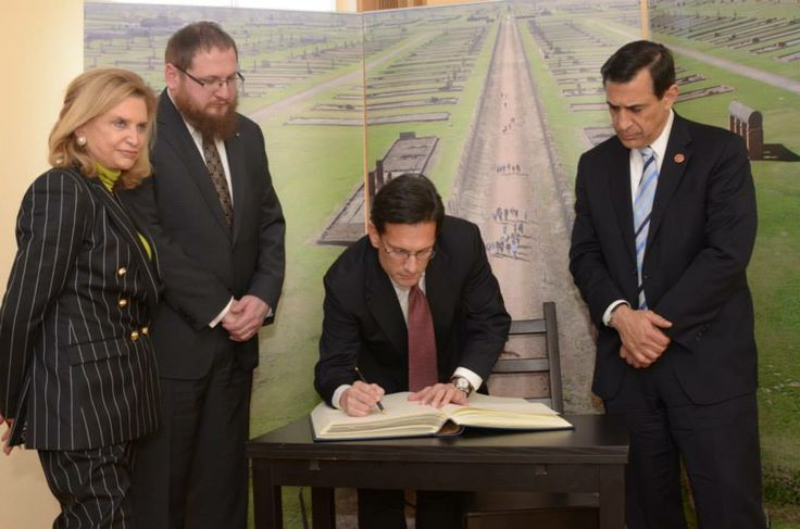 US Congressman Eric Cantor signing into the Museum's Guestbook.