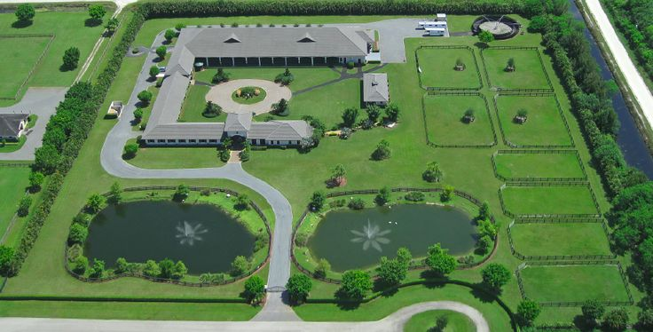 on just 5 acres this horse farm has it all ... elegance, covered arena, stunning porte-cochere entry, immaculate stables, exquisite home, manager's apartment, grass turn out, round pen...