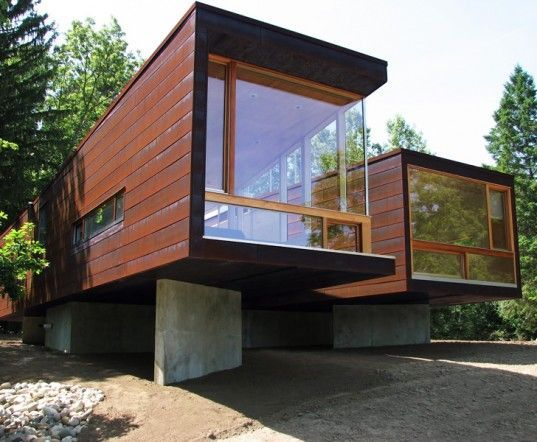 Container home with large windows and elevated on cement for Smart haus container