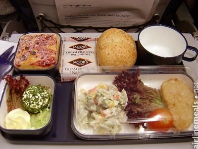 Munich To Tel Aviv Bread and butter. Cheese spread. Vegetable salad. Cream crackers. Fruit cake and a mini schnitzel.