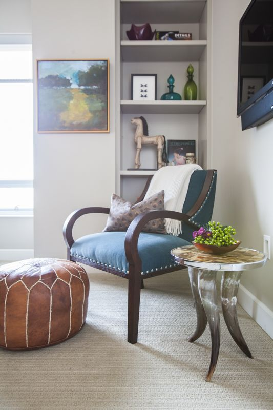 Creative Tonic - Courtnay Tartt Elias: Bachelor Pad leather ottoman, peacock blue chair, horn table and art in the master sitting area; Julie Soefer Photography