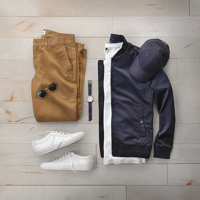 A combo I'll never get tired of.  Jacket: @bonobos Boulevard Bomber T-Shirt: @nonationality07 Pima Cotton Chinos: @taylorstitch Slim British Khaki Shoes: @commonprojects Achilles Low Watch: @miansai Hat: @varsityheadwear Navy College Series Sunglasses: @rayban Metal Round Folding ___ www.thepacman82.com