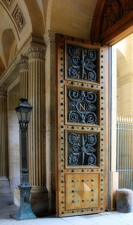 The door is open in Paris ~ Ornate door leading to the east courtyard at the Louvre. Photo by Andrew Fare in 2012.