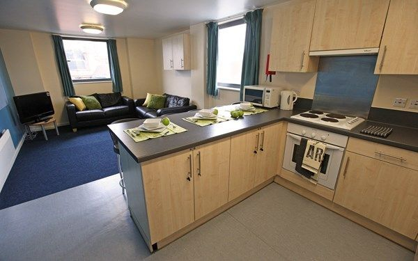A sociable kitchen laid out so you can talk whilst cooking, as well as chill out with some good home cooked food.