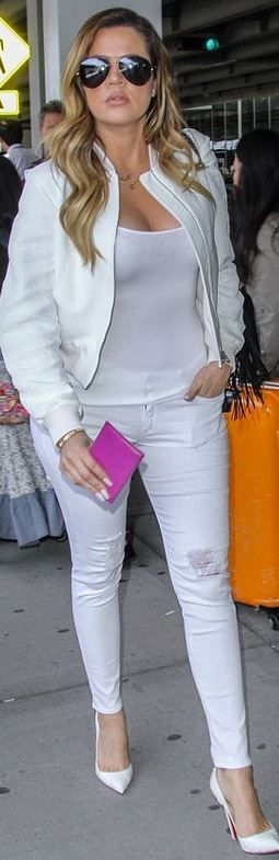 Khloe Kardashia: Jeans – Black Orchid  Sunglasses – Porsche  Bracelet – Cartier  purse – Chanel  Shoes – Christian Louboutin