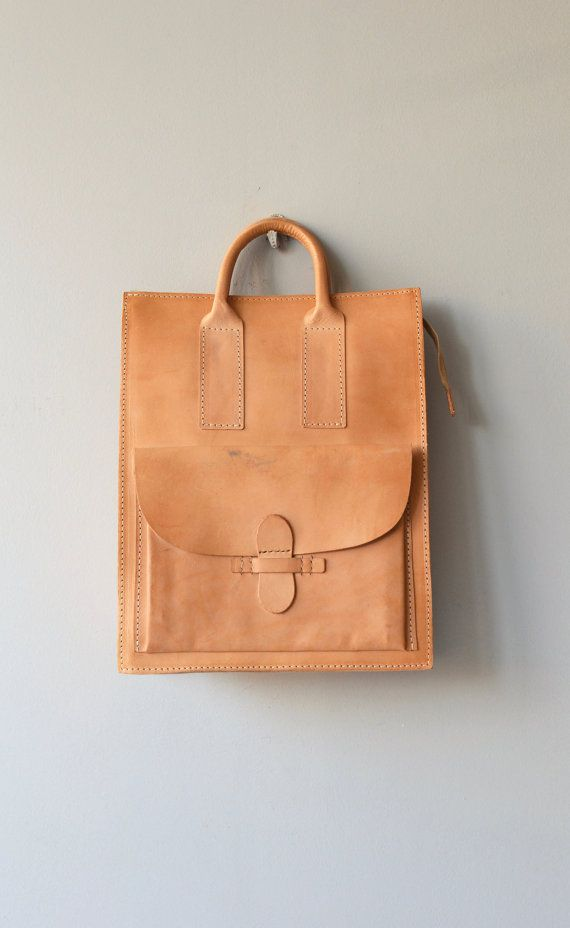 Vintage natural, untanned leather (will darken with exposure to the sun) tote with zippered top closure, larger interior ,gusseted bottom, short
