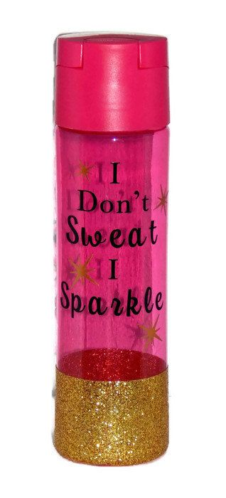 Plastic water bottles help you stay hydrated on the go! This Pink with Gold Glitter Bottom bottle has a large opening design, screw-on caps, and flip-top closures. Its perfect for cyclists, runners, hikers, promotional door prizes, and gift-bag stuffers. bottle measure 2¾ diameter and 9½ in height. 22 oz. fl. BPA FREE! HANDWASH ONLY
