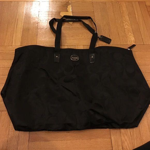 COACH duffle bag Gorgeous black COACH duffle bag with black printed C's. In brand new condition, only used once. Perfect for overnight getaways! Coach Bags Travel Bags