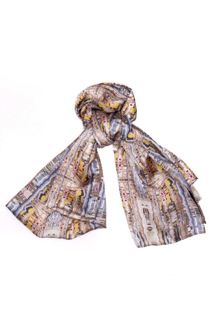 Port of Passion - Long Scarf.  This unique collection of colors creates a beautiful abstract art that will accentuate and emphasize your expression of individuality. Become the trend setter and break apart from the crowd with this vibrant yet simplistic scarf. It works for any season and can be worn to add some flare to your outfit.