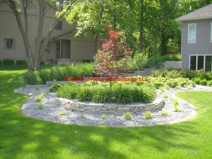 Residential landcape design japanese maple tree stone for Ornamental grass edging